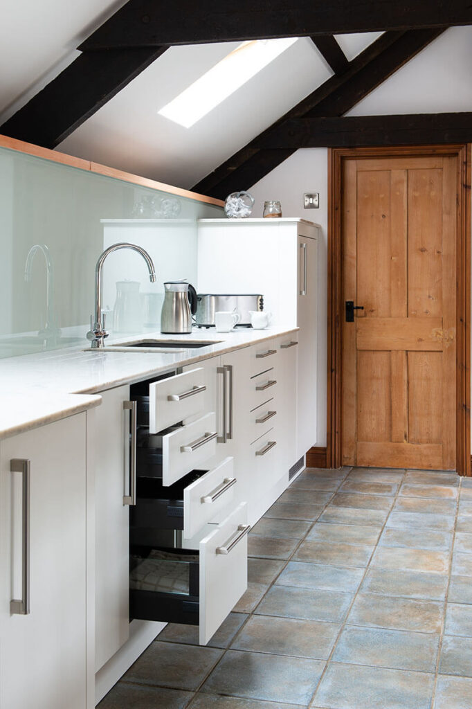 The kitchen also featured plenty of practical storage solutions.
