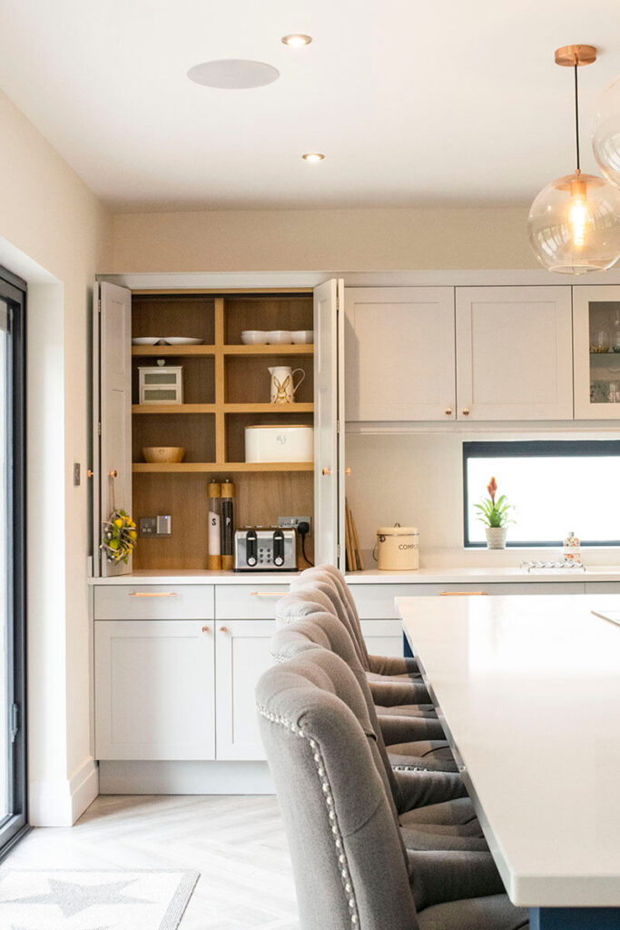 Another angle of the bespoke pantry unit with bespoke bi-fold door