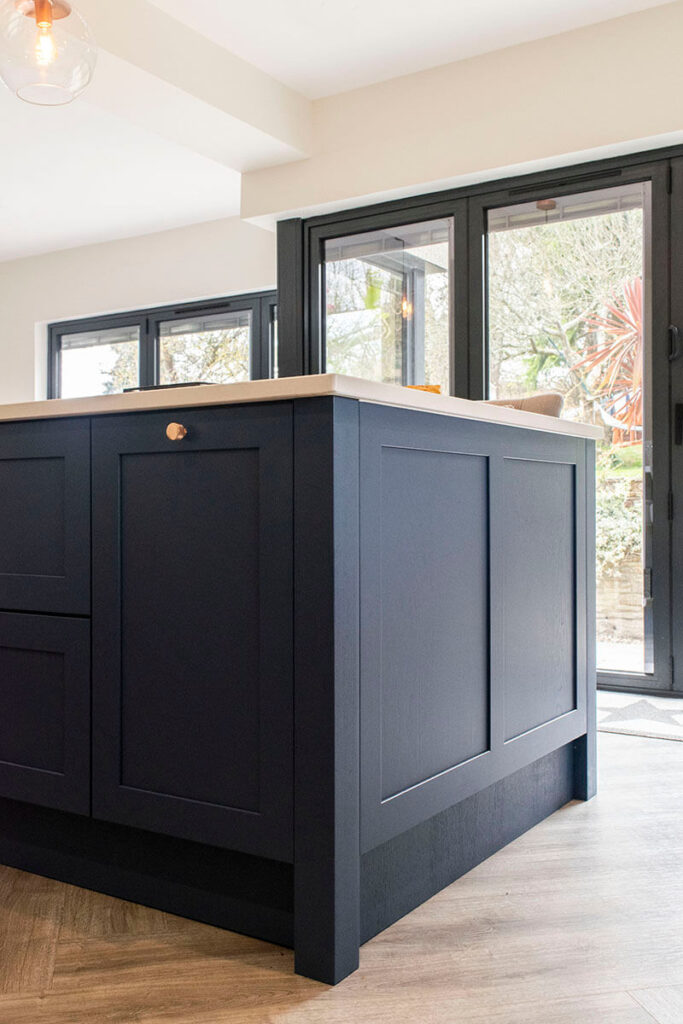 The kitchen island is finished in Parisian blue