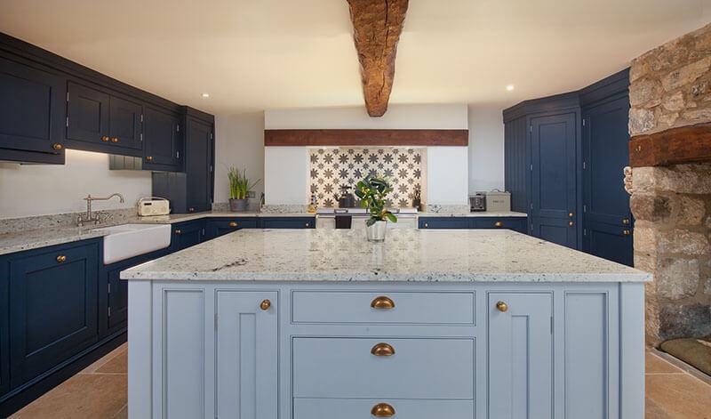 Quartz worktops in farmhouse kitchen