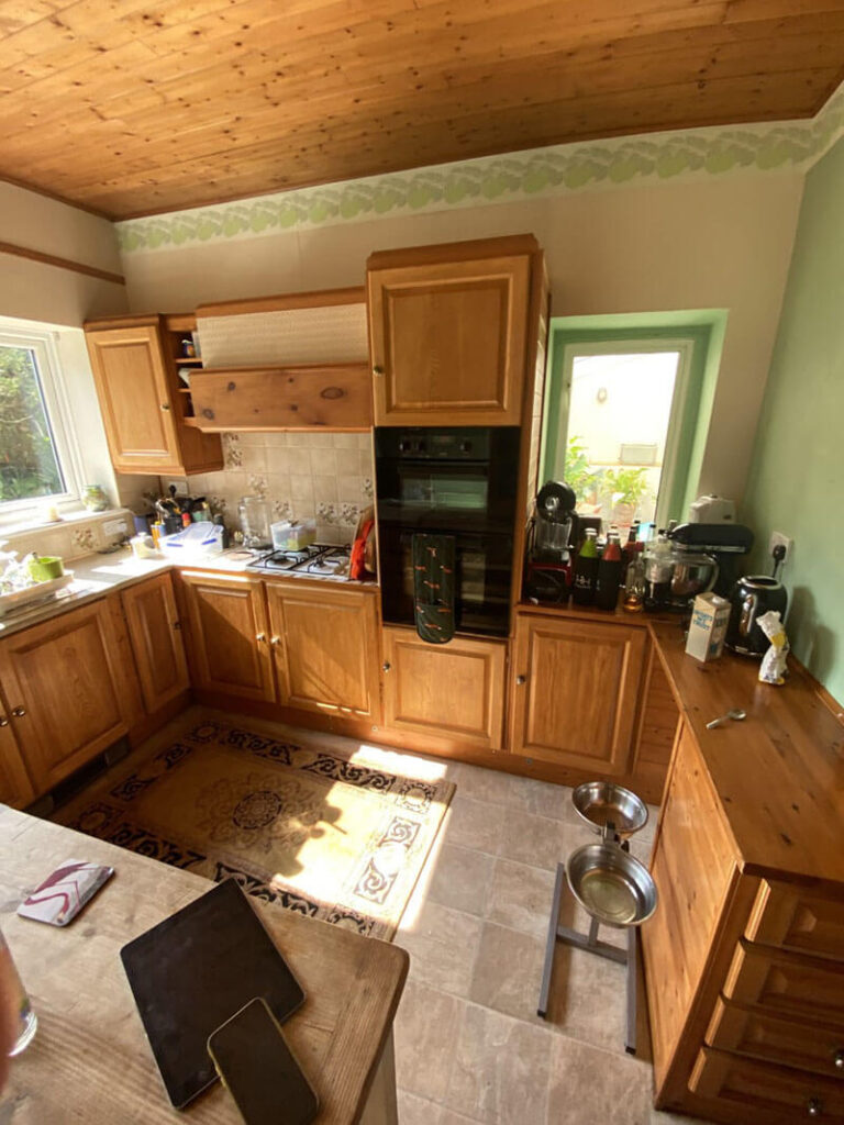 Our client's old-fashioned pine kitchen and outdated décor