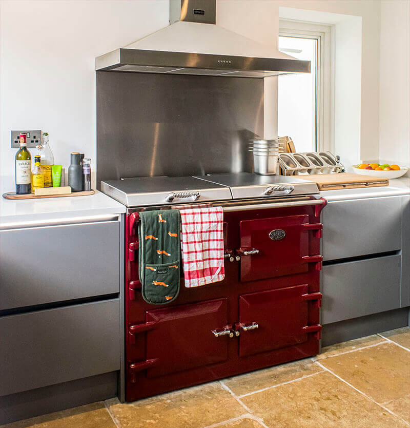 The red Everhot range cooker offers a welcome dash of colour