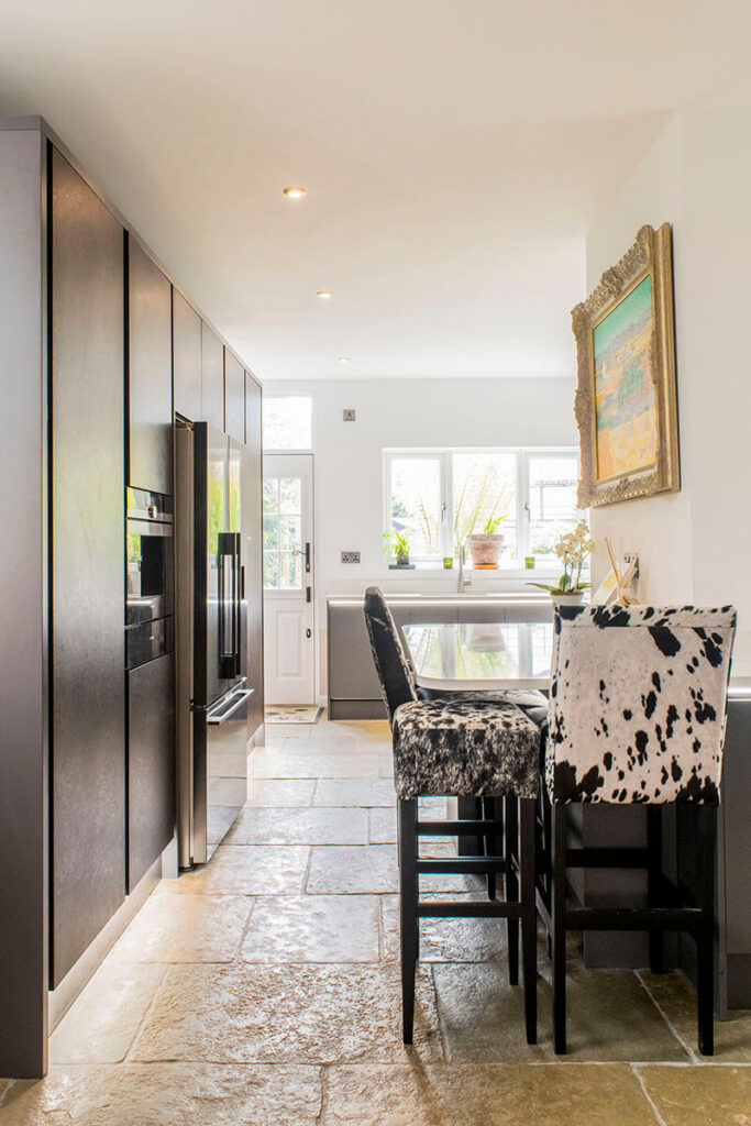 The natural stone flooring provides a hard wearing floor surface that also offers a warmth that brings balance to the rest of the kitchen.