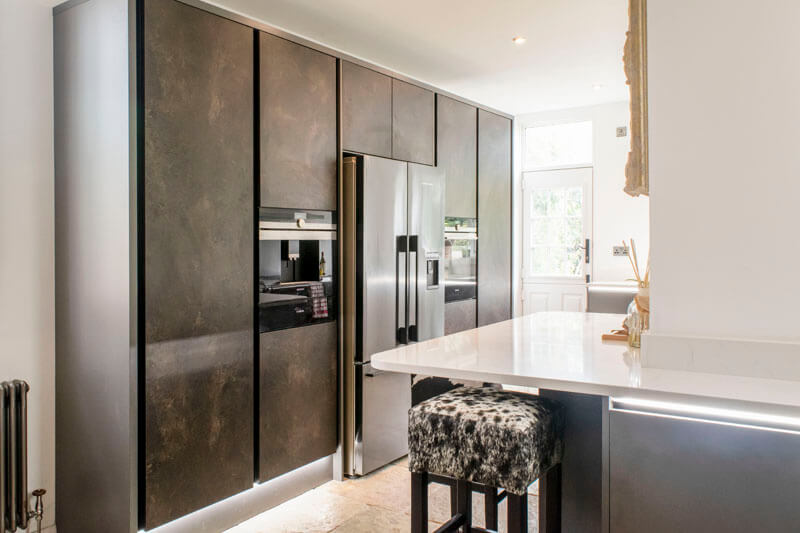 At the heart of this kitchen is a stunning wall larder finished in ceramic anthracite