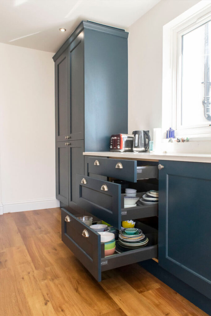 Finished in Hague Blue, this bespoke-painted, solid ash kitchen features our Cotehele signature door.