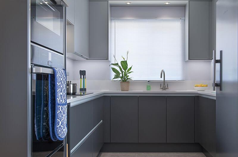 Small kitchen featuring grey handleless doors