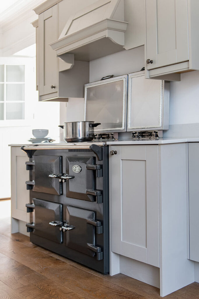 The Everhot range cooker is surrounded by a bespoke-designed breakfront canopy
