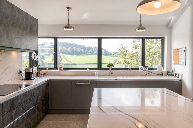 The kitchen features a sleek modern interior