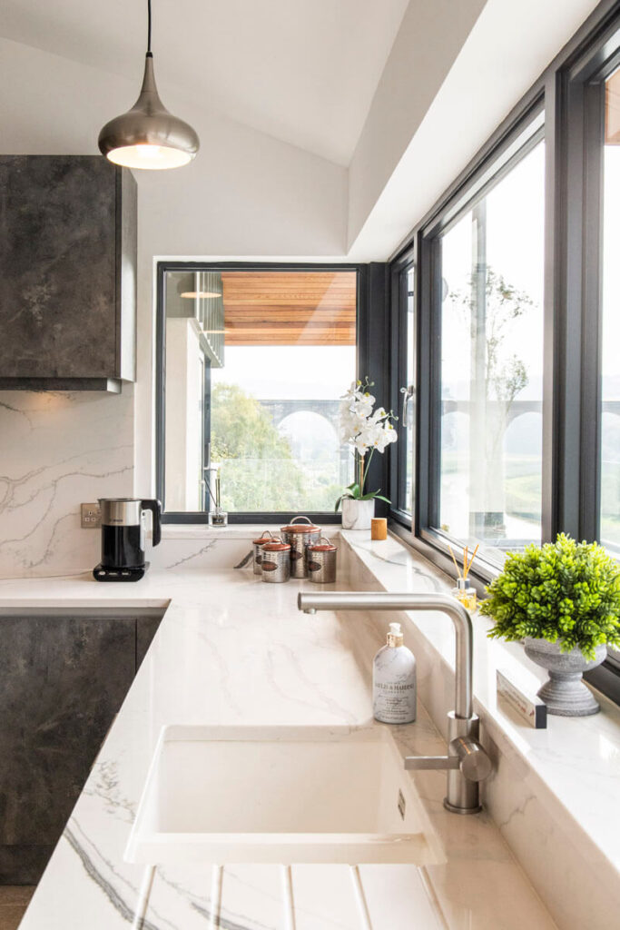 A white ceramic Caple sink and a stainless steel Lanora mixer tap from Blanco.